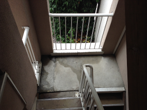 Sown here: Untreated Suspended Concrete Slab of an Outdoor Covered Stairwell that is exposed to rainfall